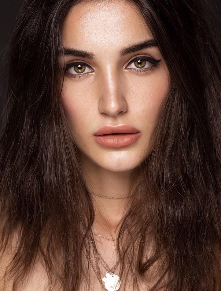 Female model close up dark hair pink lipstick
