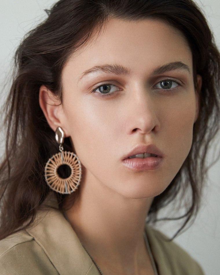 Female model close up dark hair big ear ring