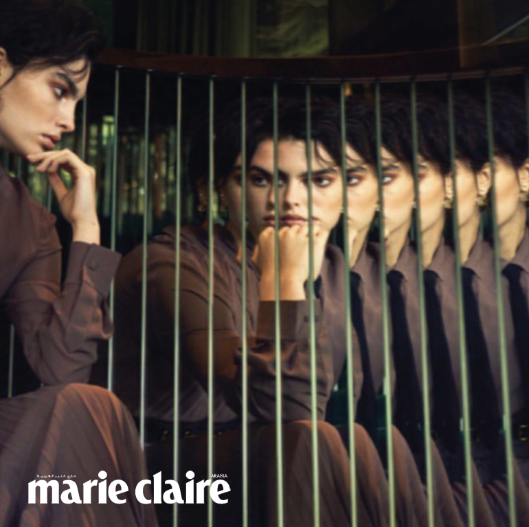 Arina Fishman for Marie Claire Magazine looking into mirror
