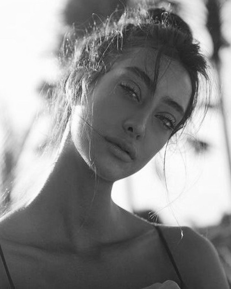 Female model black and white photo close up sun behind in shadow