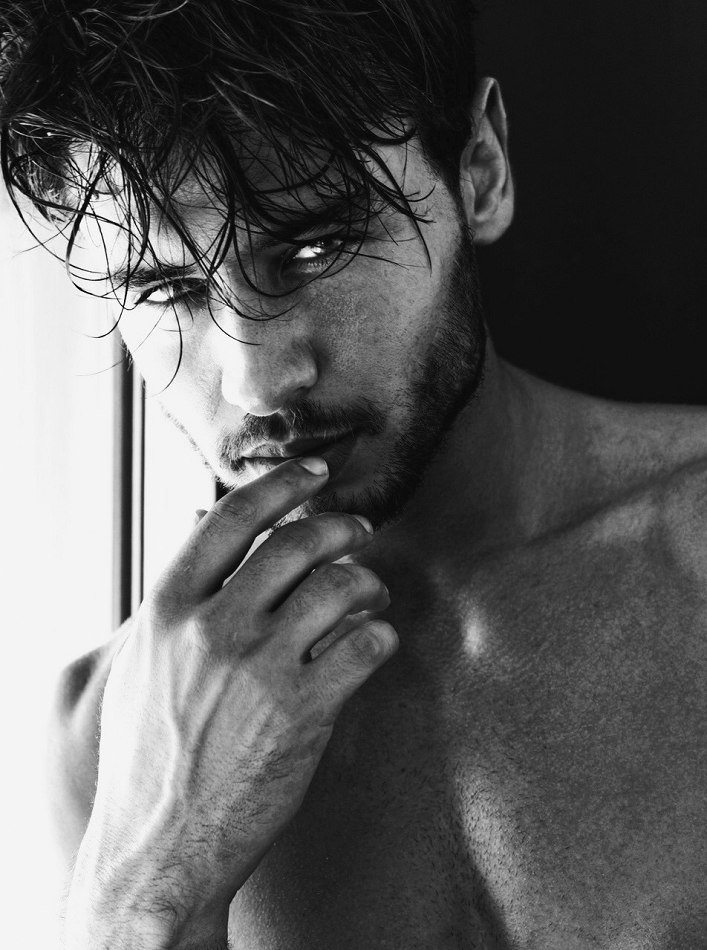 Male model black and white photo hand over mouth close up