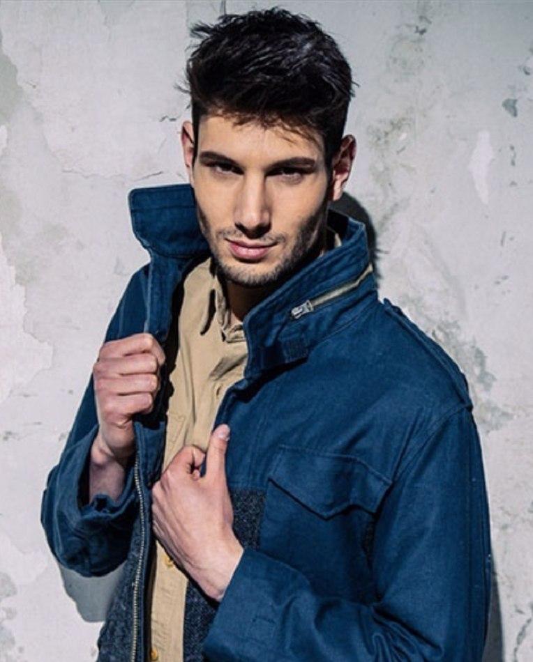 Male model Marco wearing blue jacket white background