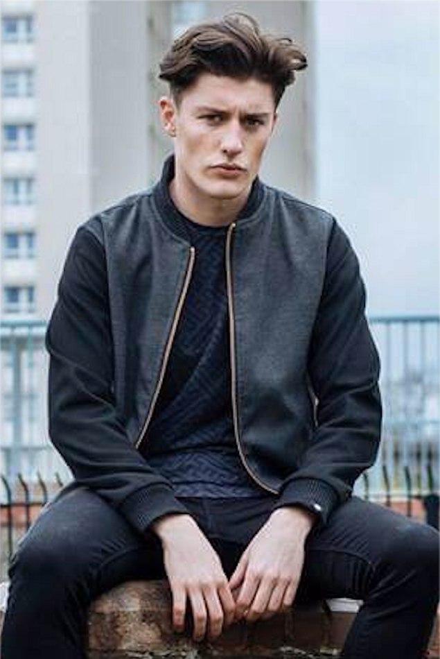 Male Model Paul C Sitting down wearing black jacket