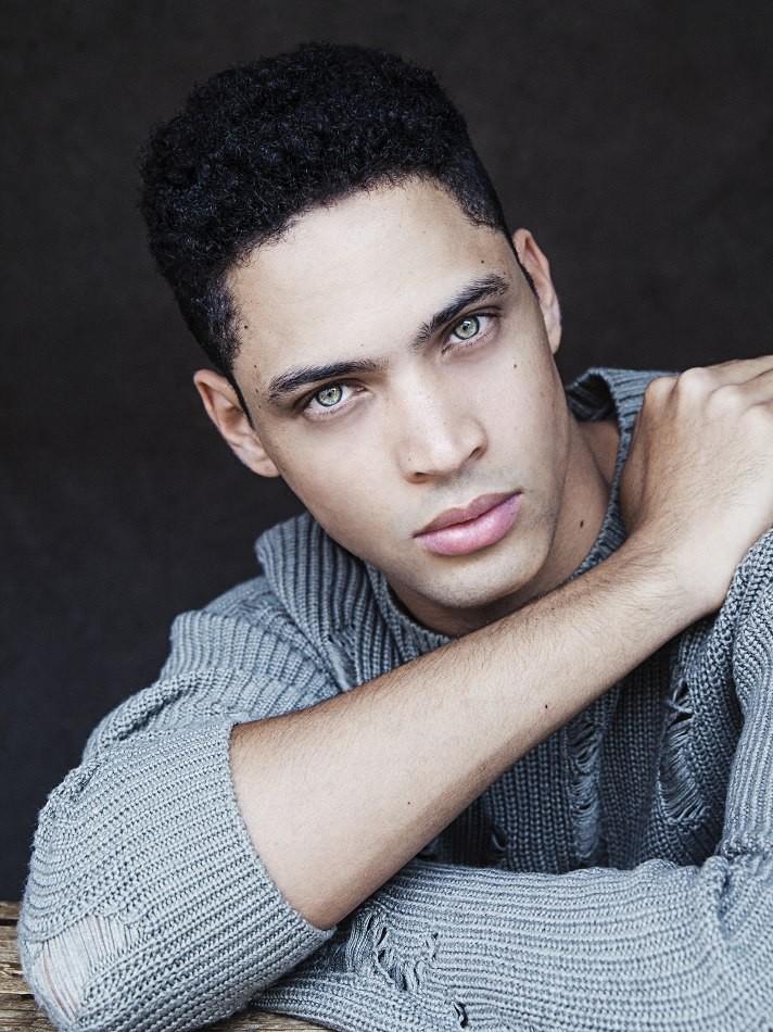Male model Erick dark hair wearing grey jumper