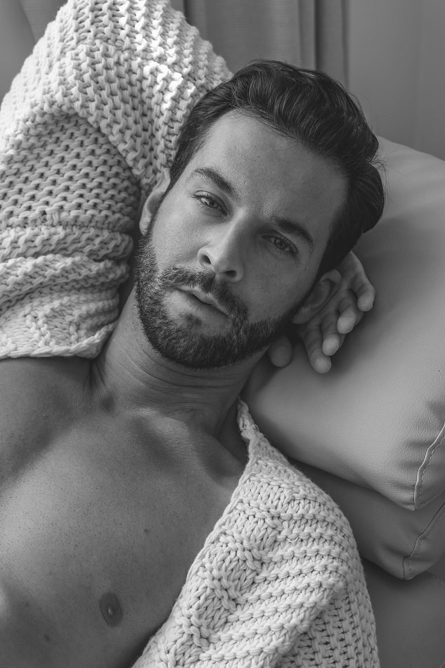Male model Jan laying down black and white photo