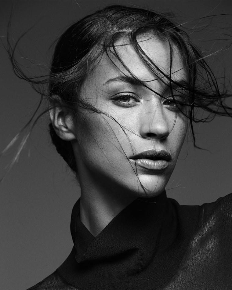 Female model black and white photo wind swept hair close up