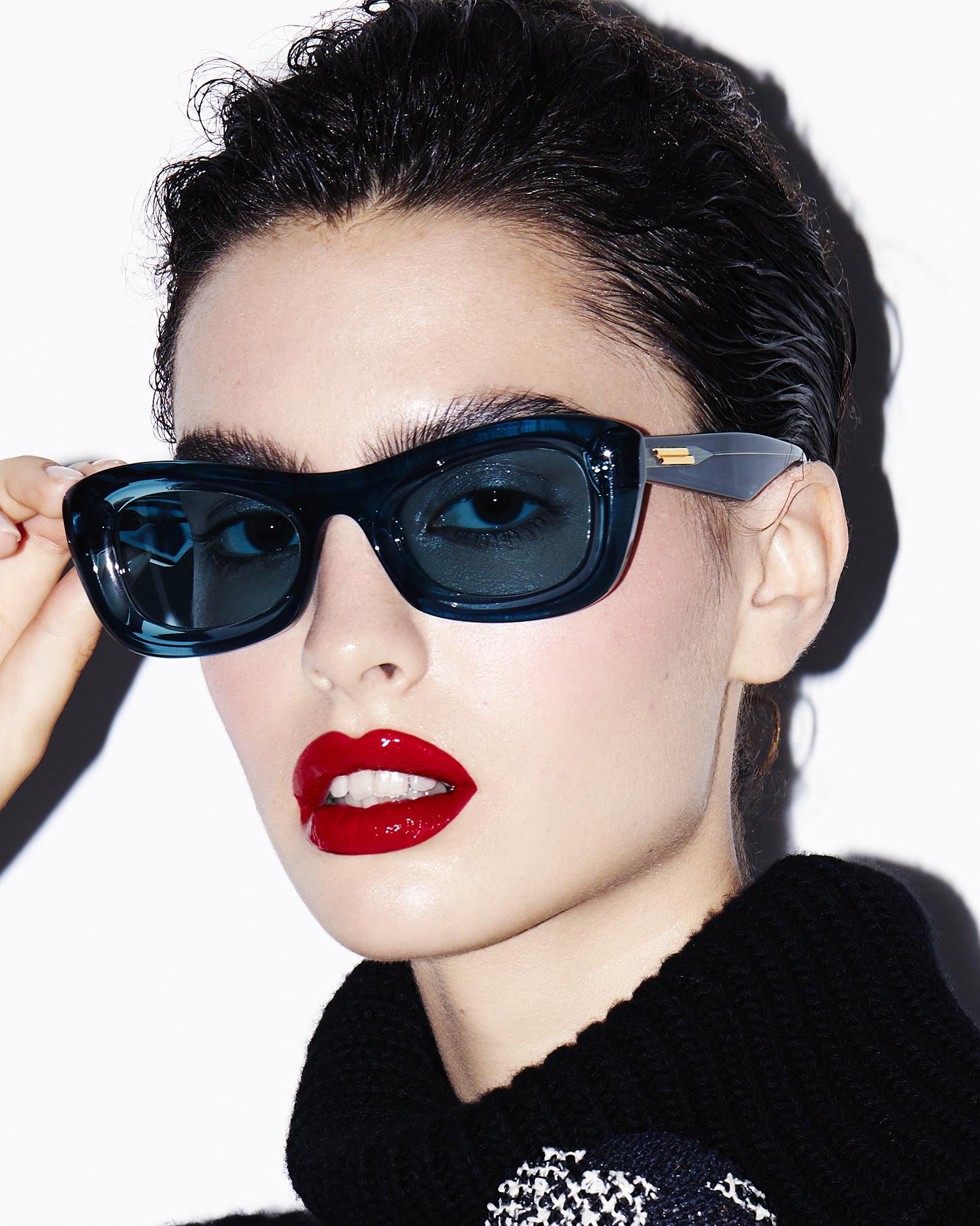 female model dark hair headshot wearing sunglasses red lipstick