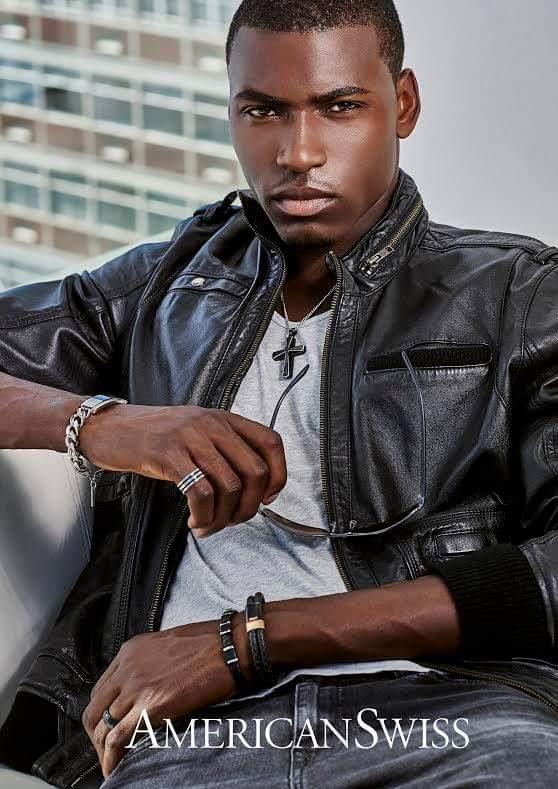 Male model Irvine sitting wearing black jacket