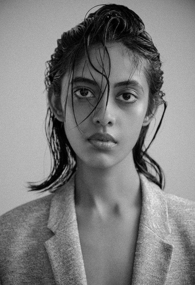 Female model black and white photo wearing suit jacket wet looking hair
